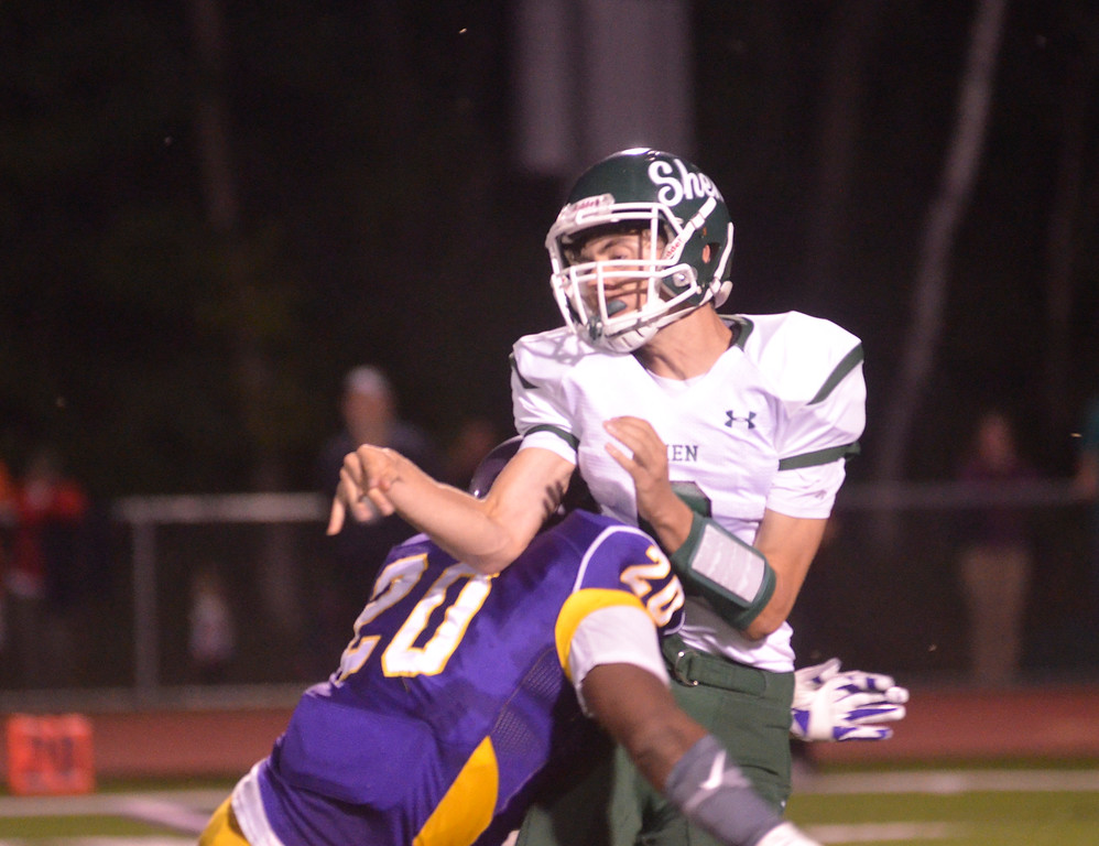 . James Costanzo - jcostanzo@digitalfirstmedia.com Troy defensive end Jessie Brown hits Shen quarterback Mike Spulnik in the 2016 season opener at Troy High School on Sept. 2, 2016.
