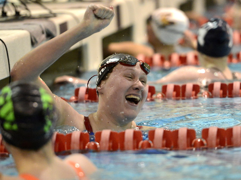 Thompson Valley senior Sophie Kubik cheers after winning her conslation final of the 100-yard butterfly by .01 Saturday Feb. 10, 2018 at the state swimming meet at the VMAC in Thornton. (Cris Tiller / Loveland Reporter-Herald)