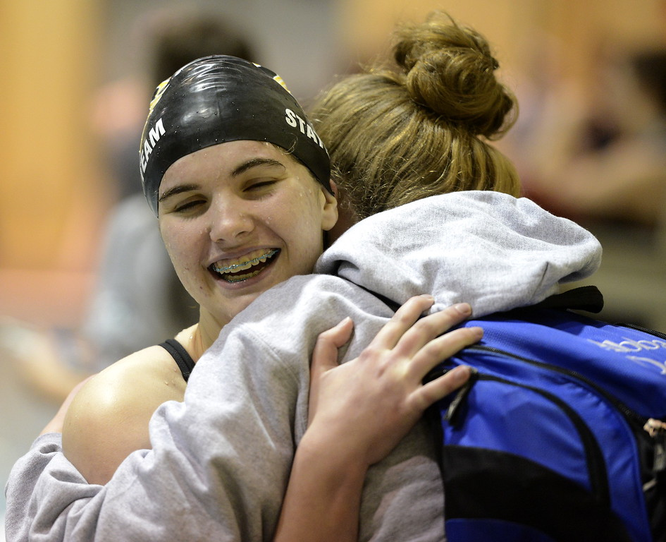 Thompson Valley's Emily Fulp hugs a teammate during the state swimming meet Saturday at the VMAC in Thornton. (Cris Tiller / Loveland Reporter-Herald)