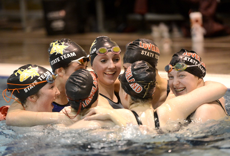 Loveland and Thompson Valley swimmers celebrate together at the state swimming meet Saturday Feb. 10, 2018 at the VMAC in Thornton. The two teams share friendships through the Loveland Swim Club. (Cris Tiller / Loveland Reporter-Herald)