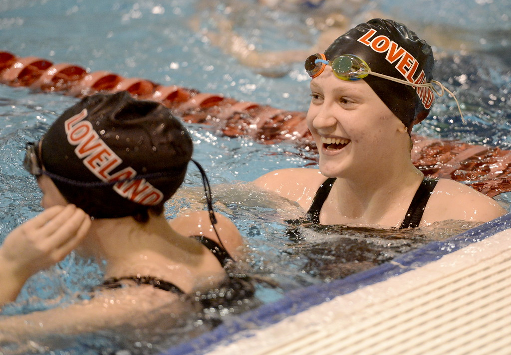 . Loveland sophomore Erin Lang, left, smiles with her teammates after winning a second straight state championship in the 500-yard freestyle Saturday Feb. 10, 2018 at the state swimming meet at the VMAC in Thornton. (Cris Tiller / Loveland Reporter-Herald)