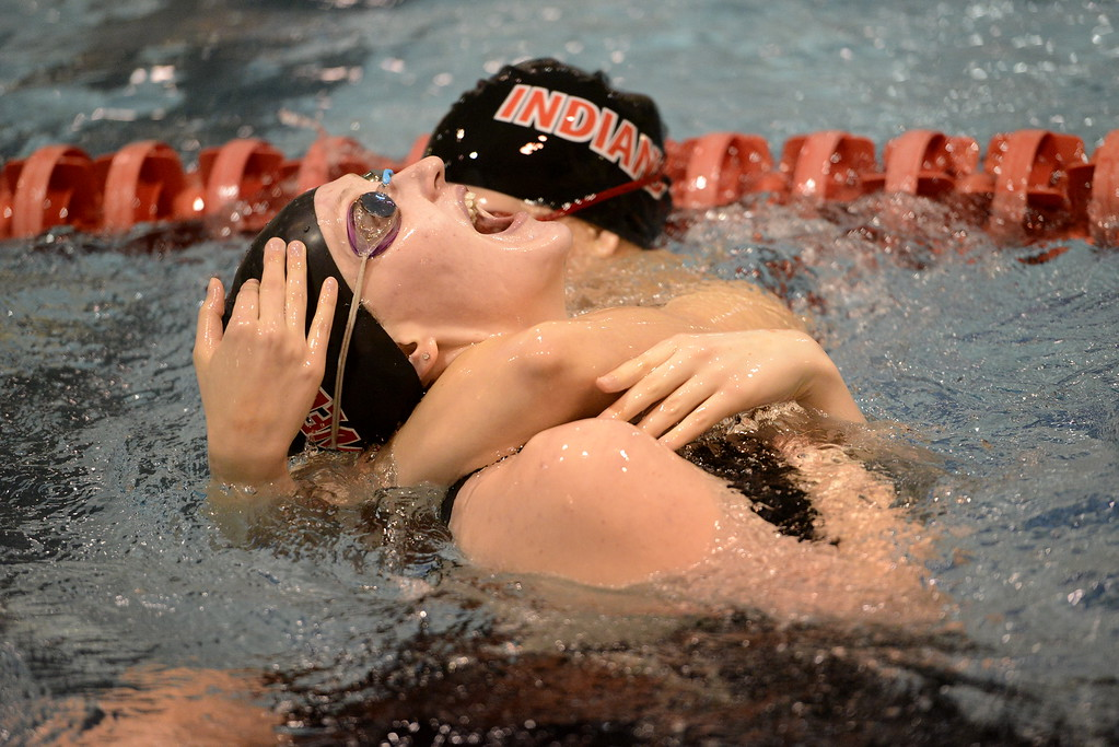 . Loveland junior Erin Lang goofs around with a teammate in the warm-up pool during the state swimming meet Saturday at the VMAC in Thornton. (Cris Tiller / Loveland Reporter-Herald)