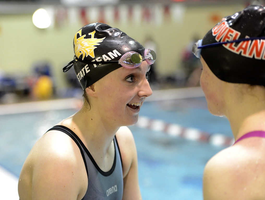 . Thompson Valley\'s Adley Morison smiles with friend Josie Brohard during the state swimming meet at the VMAC in Thornton. (Cris Tiller / Loveland Reporter-Herald)
