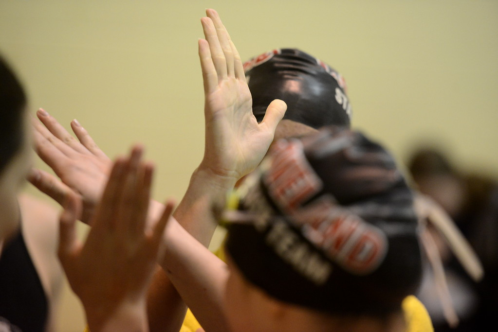 . Loveland teammates come together for a high five during the state swimming meet Saturday at the VMAC in Thornton. (Cris Tiller / Loveland Reporter-Herald)