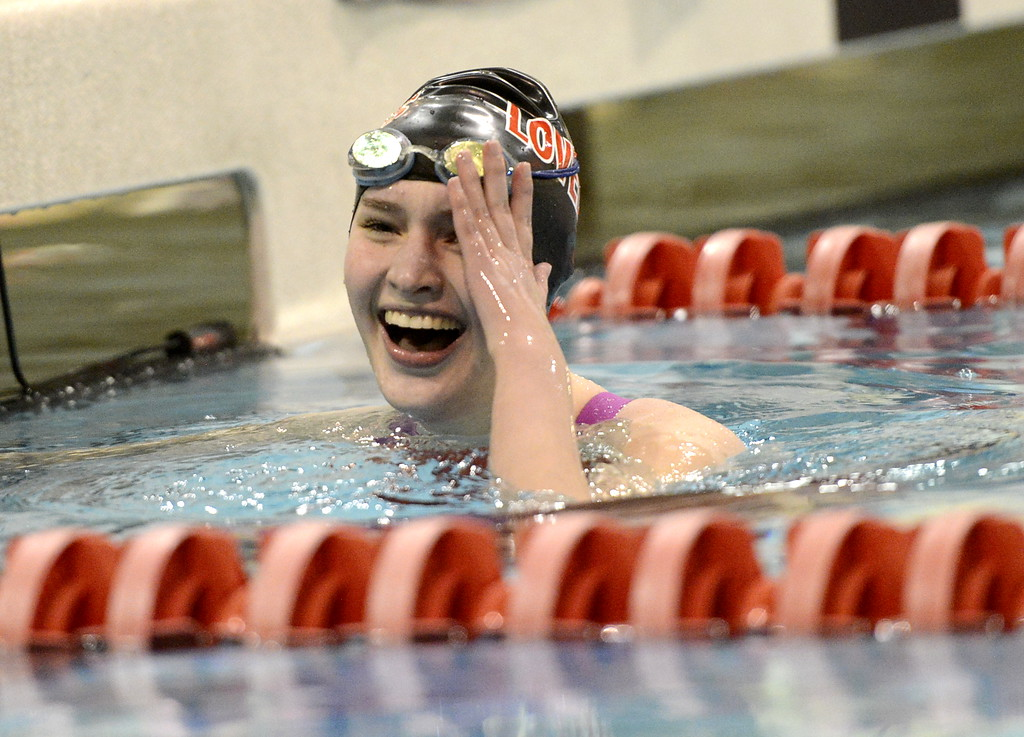 . Loveland junior Josie Brohard reacts to finishing fifth in the 100-yard backstroke Saturday Feb. 10, 2018 at the state swimming meet at the VMAC in Thornton. (Cris Tiller / Loveland Reporter-Herald)
