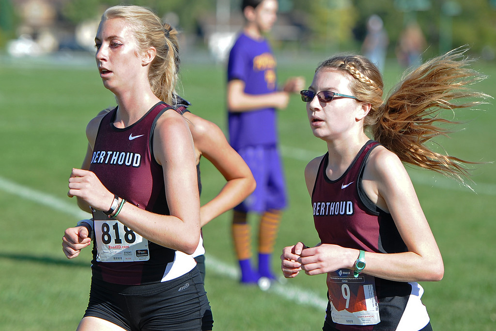 . Berthoud\'s Cailey Archer, left, and Ellie Sundheim run at the Loveland Sweetheart Invitational on Friday, Sept. 21, 2018 at Loveland High School. (Sean Star/Loveland Reporter-Herald)
