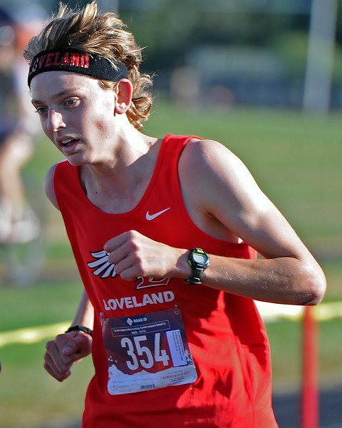 Loveland's Stephen Ritschard finishes the Loveland Sweetheart Invitational on Friday, Sept. 21, 2018 at Loveland High School. (Sean Star/Loveland Reporter-Herald)