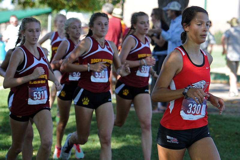 Loveland's Kennedy Burch, right, runs ahead of a pack from Rocky Mountain at the Loveland Sweetheart Invitational on Friday, Sept. 21, 2018 at Loveland High School. (Sean Star/Loveland Reporter-Herald)