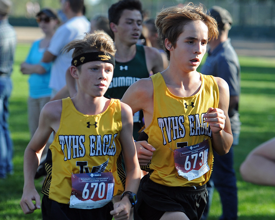 . Thompson Valley\'s Damien Cooper, left, and Bode Shiver run at the Loveland Sweetheart Invitational on Friday, Sept. 21, 2018 at Loveland High School. (Sean Star/Loveland Reporter-Herald)