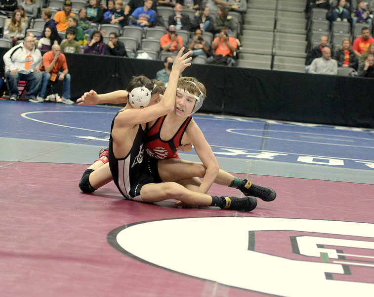 Loveland's Cody Thompson regains control in his 106-pound first-round match against Pueblo South's Mac Martinez on Thursday at the Pepsi Center in Denver. Thompson won an 8-6 decision.