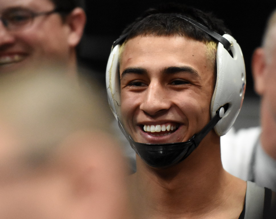 Mountain View's Erik Contreras smiles befores his first-round match of the state wrestling tournament at the Pepsi Center in Denver on Thursday. (Cris Tiller / Loveland Reporter-Herald)