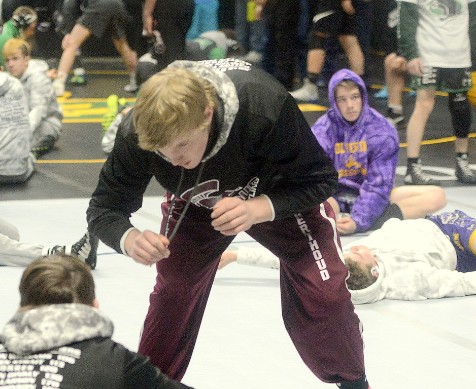 Berthoud's Wyatt Larson messes around with teammate Brock Johnson prior to the start of the opening round of the 3A state wrestling tournament Thursday at the Pepsi Center in Denver. The Spartans qualified seven for the field.