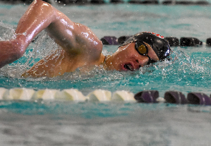 Loveland's Jakob Borrman swims the 500-yard freestyle during the City Swim Meet on Wednesday April 11, 2018 at the MVAC. (Cris Tiller / Loveland Reporter-Herald)