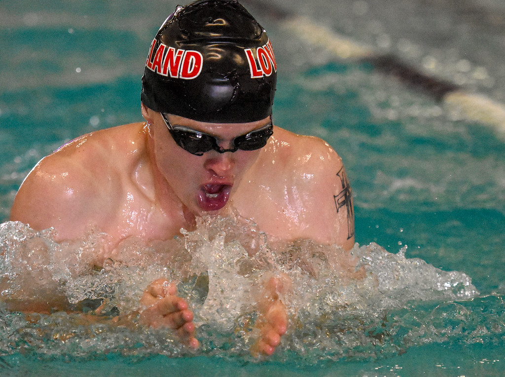 . Loveland\'s Danny Turner swims the 100-yard breaststroke during the City Swim Meet on Wednesday April 11, 2018 at the MVAC. (Cris Tiller / Loveland Reporter-Herald)