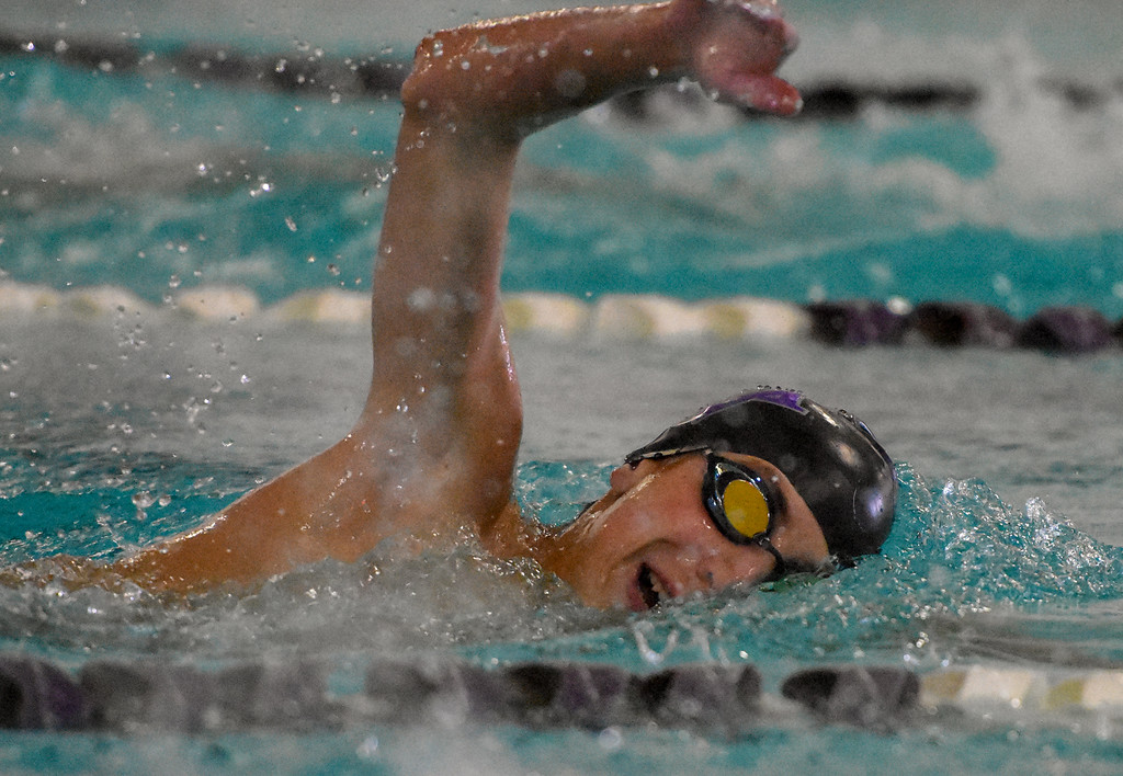 . Mountain View\'s Max Bridges swims the 500-yard freestyle during the City Swim Meet on Wednesday April 11, 2018 at the MVAC. (Cris Tiller / Loveland Reporter-Herald)