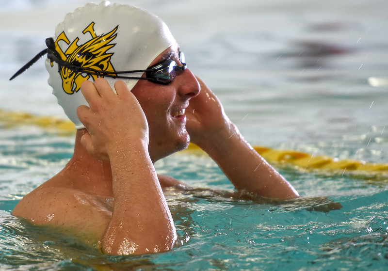 Thompson Valley's Michael Vierra smiles in warmups during the City Swim Meet on Wednesday April 11, 2018 at the MVAC. (Cris Tiller / Loveland Reporter-Herald)