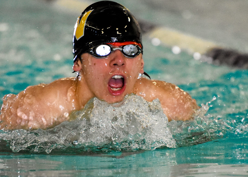 Thompson Valley's Donovan Love swims the breakstroke leg of the 200 IM during the City Swim Meet on Wednesday April 11, 2018 at the MVAC. (Cris Tiller / Loveland Reporter-Herald)
