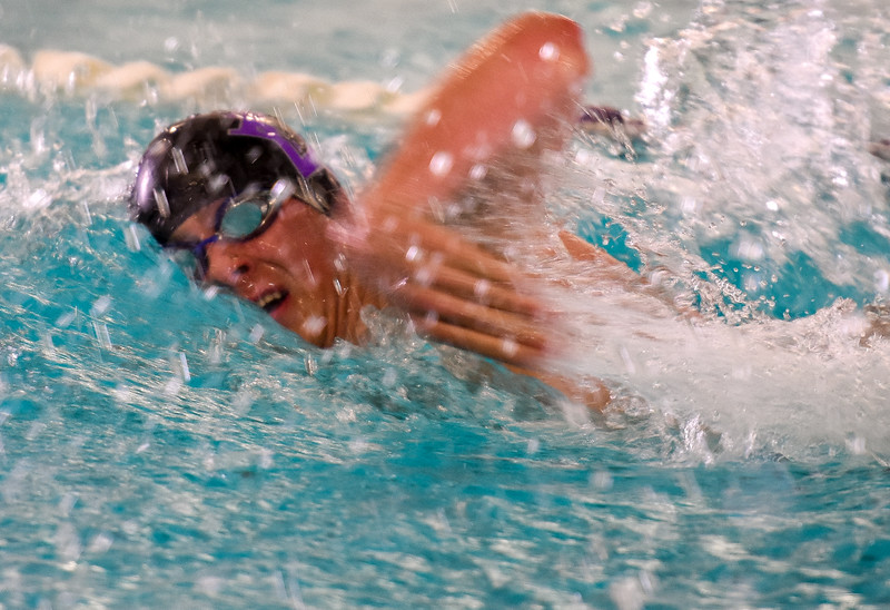 Mountain View's Jonathan Zakanycz swims the 100-yard freestyle during the City Swim Meet on Wednesday April 11, 2018 at the MVAC. (Cris Tiller / Loveland Reporter-Herald)
