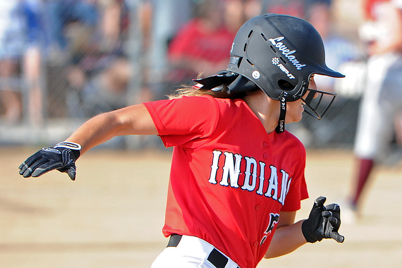 Jordan Irwin rounds first during Loveland's softball game against Berthoud on Thursday, Aug. 23, 2018 at Centennial Park in Loveland, Colorado. (Sean Star/Loveland Reporter-Herald)