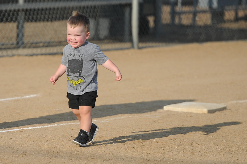 A young fan makes his way to home plate after Loveland's softball game against Berthoud on Thursday, Aug. 23, 2018 at Centennial Park in Loveland, Colorado. (Sean Star/Loveland Reporter-Herald)