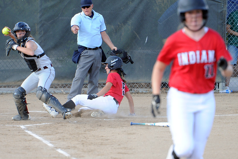 Berthoud catcher Mandi Laib throws to first as Loveland's Jordan Irwin slides behind a force out at the plate during Loveland's softball game against Berthoud on Thursday, Aug. 23, 2018 at Centennial Park in Loveland, Colorado. (Sean Star/Loveland Reporter-Herald)