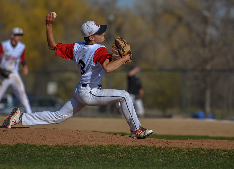 Loveland's Eli Knodel pitches in relief against Monarch on Thursday April 26, 2018 at Swift Field. (Cris Tiller / Loveland Reporter-Herald)