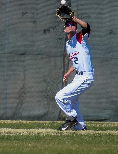 Loveland centerfielder Drew Massey attempts a catch against Monarch on Thursday April 26, 2018 at Swift Field. (Cris Tiller / Loveland Reporter-Herald)