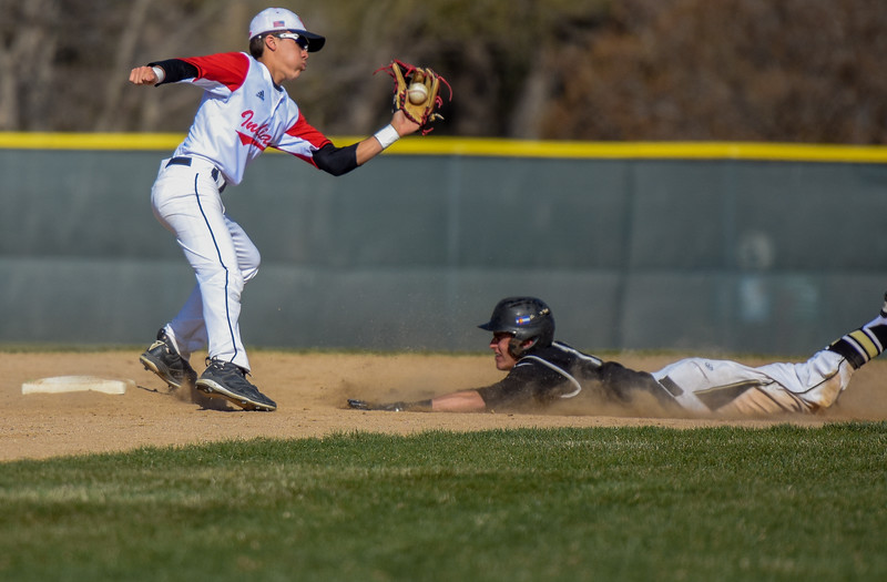 Loveland second baseman Jaxon Cabrera makes a catch in front of a Monarch base stealer on Thursday April 26, 2018 at Swift Field. (Cris Tiller / Loveland Reporter-Herald)