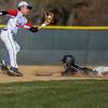 Loveland second baseman Jaxon Cabrera makes a catch in front of a Monarch base stealer on Thursday April 26, 2018 at Swift Field. (Cris Tiller / Loveland Reporter-Herald)