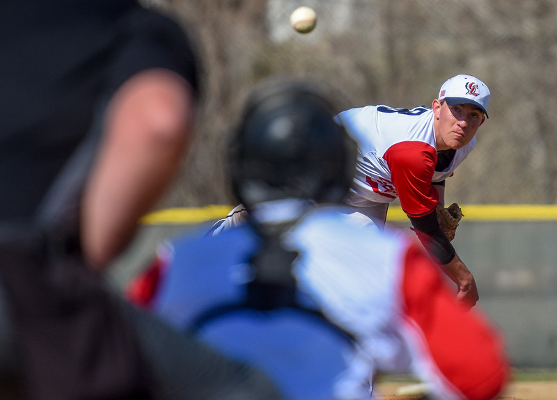 Loveland starting pitcher Kyle Irwin delivers a strike against Monarch on Thursday April 26, 2018 at Swift Field. (Cris Tiller / Loveland Reporter-Herald)