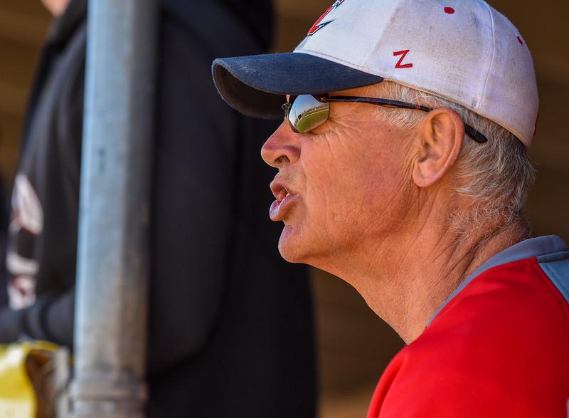 Loveland baseball coach Greg Brock yells out instructions from the dugout against Monarch on Thursday April 26, 2018 at Swift Field. (Cris Tiller / Loveland Reporter-Herald)