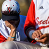 A Loveland baseball players rests his head in his hands after a mercy-rule loss against Monarch on Thursday April 26, 2018 at Swift Field. (Cris Tiller / Loveland Reporter-Herald)