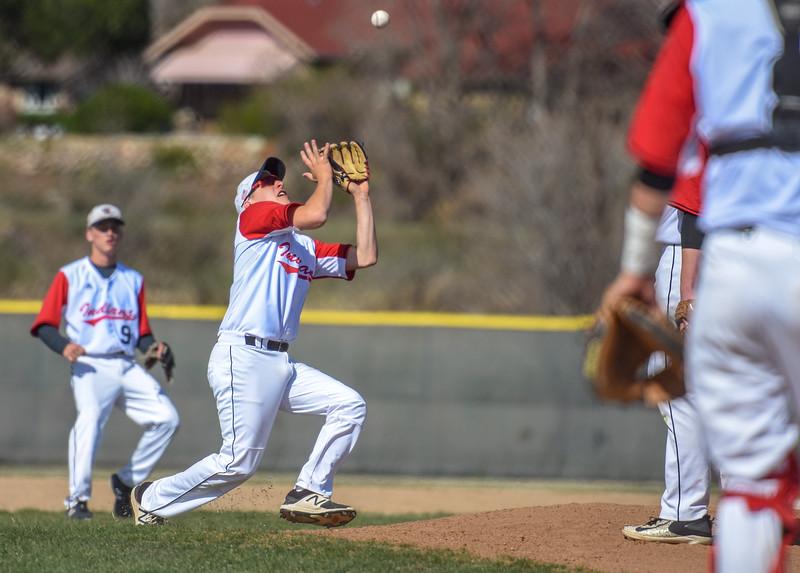 Loveland third baseman Jackson Bakovich makes a catch against Monarch on Thursday April 26, 2018 at Swift Field. (Cris Tiller / Loveland Reporter-Herald)