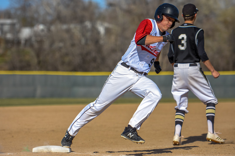 Loveland's Tyler Hamill rounds third base to score a run against Monarch on Thursday April 26, 2018 at Swift Field. (Cris Tiller / Loveland Reporter-Herald)