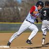 Loveland's Tyler Hamill rounds third base to score a run against Monarch on Thursday April 26, 2018 at Swift Field. (Cris Tiller / Loveland Reporter-Herald)