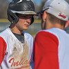 Loveland's AJ Cortese is congratulated after hitting a triple against Monarch on Thursday April 26, 2018 at Swift Field. (Cris Tiller / Loveland Reporter-Herald)