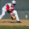 Loveland second baseman Jaxon Cabrera fields a ground ball against Monarch on Thursday April 26, 2018 at Swift Field. (Cris Tiller / Loveland Reporter-Herald)