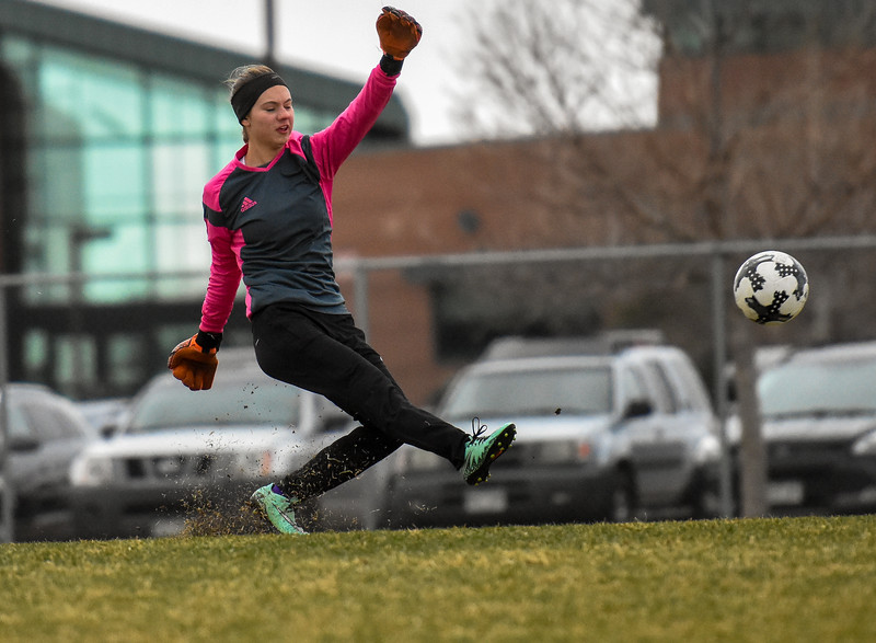 Mountain View goalkeeper Shelby Olson takes a free kick against Loveland on Thursday March 29, 2018 at MVHS. (Cris Tiller / Loveland Reporter-Herald)