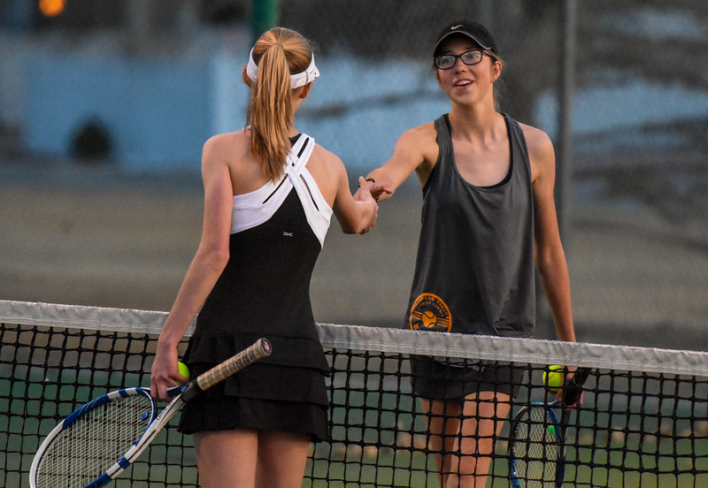 Thompson Valley's Kylie Jacobson shakes hands after losing to Loveland's Ava McQuade on Thursday March 8, 2018 at North Lake Park. (Cris Tiller / Loveland Reporter-Herald)