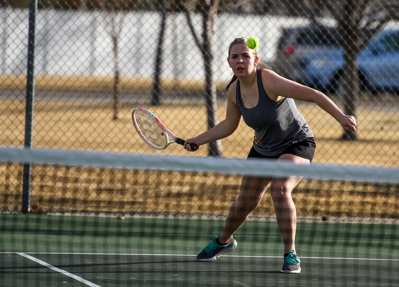 Thompson Valley's Anna Cormos eyes a forehand shot against Loveland on Thursday March 8, 2018 at North Lake Park. (Cris Tiller / Loveland Reporter-Herald)