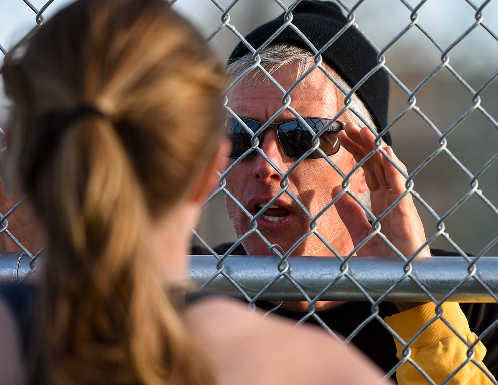 . Thompson Valley girls tennis coach Jay Klagge instructs his players on Thursday March 8, 2018 at North Lake Park. (Cris Tiller / Loveland Reporter-Herald)
