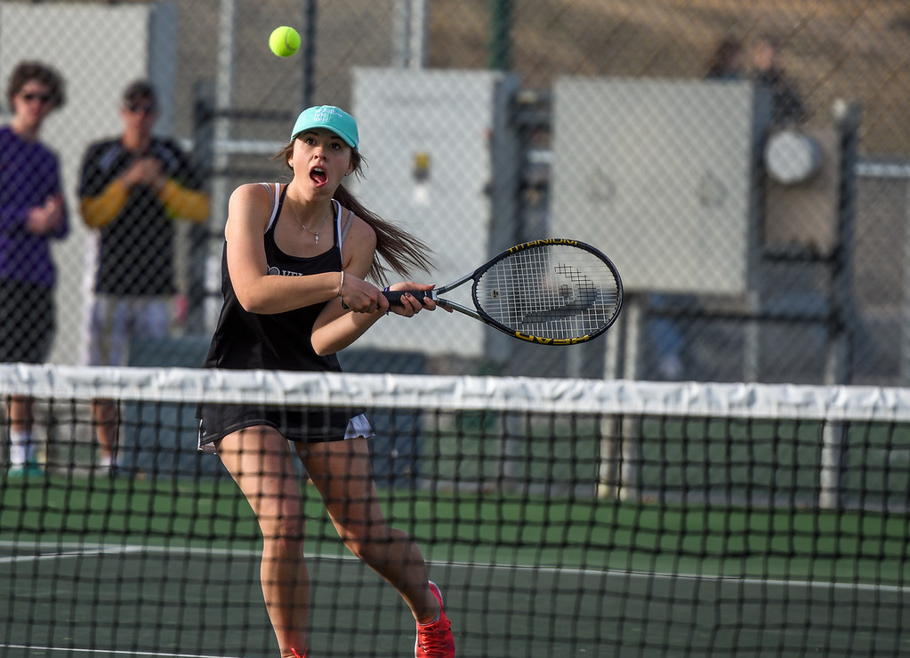 . Loveland\'s Kira Badberg hits a backhand against Thompson Valley on Thursday March 8, 2018 at North Lake Park. (Cris Tiller / Loveland Reporter-Herald)