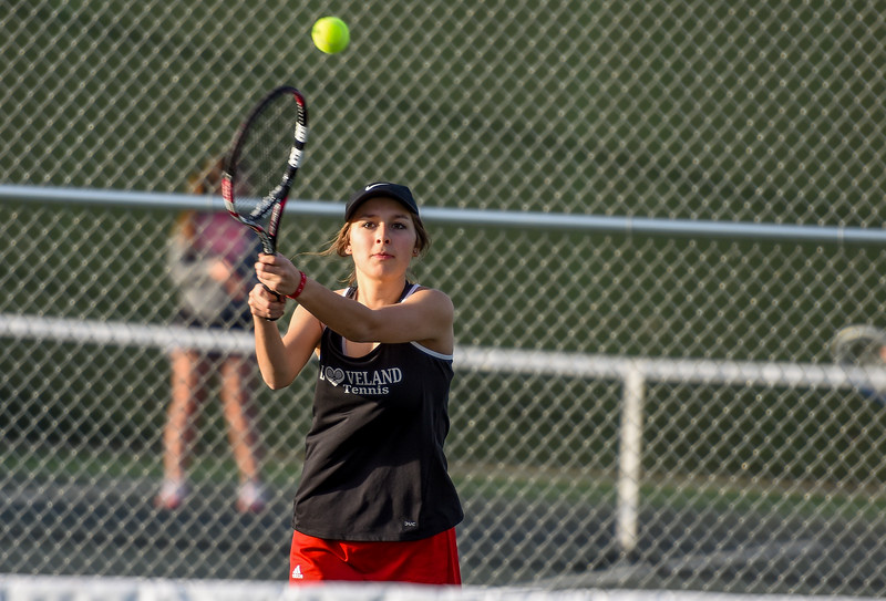 Loveland's Heather Price hits a backhand against Thompson Valley on Thursday March 8, 2018 at North Lake Park. (Cris Tiller / Loveland Reporter-Herald)