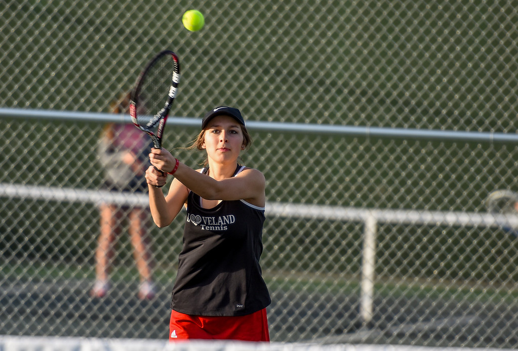 . Loveland\'s Heather Price hits a backhand against Thompson Valley on Thursday March 8, 2018 at North Lake Park. (Cris Tiller / Loveland Reporter-Herald)