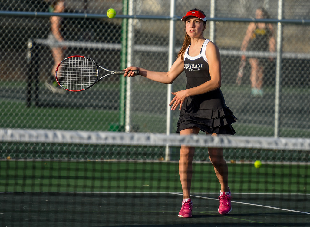. Loveland\'s Megan Lindsey hits a forehand against Thompson Valley on Thursday March 8, 2018 at North Lake Park. (Cris Tiller / Loveland Reporter-Herald)