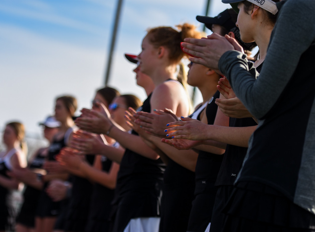 . Loveland players clap for the announcement of the lines against Thompson Valley on Thursday March 8, 2018 at North Lake Park. (Cris Tiller / Loveland Reporter-Herald)