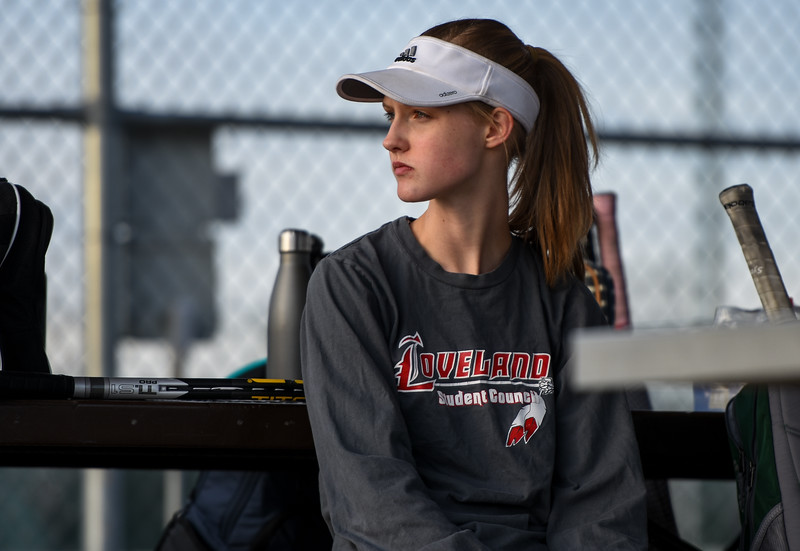 Loveland's Ava McQuade looks on while waiting to begin her third set on Thursday March 8, 2018 at North Lake Park. (Cris Tiller / Loveland Reporter-Herald)