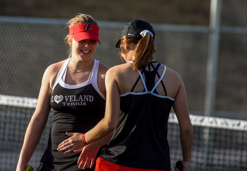 Loveland's Emily Eggerling shares a laugh with teammate Heather Price on Thursday March 8, 2018 at North Lake Park. (Cris Tiller / Loveland Reporter-Herald)