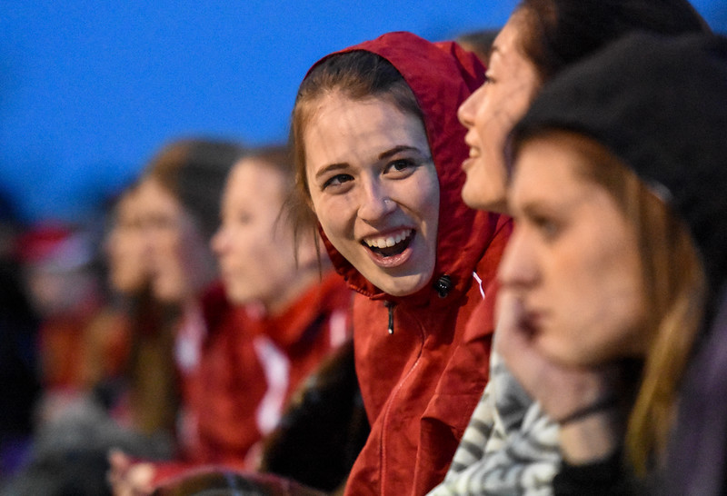 Loveland's Kira Badberg laughs with teammates on Thursday March 8, 2018 at North Lake Park. (Cris Tiller / Loveland Reporter-Herald)