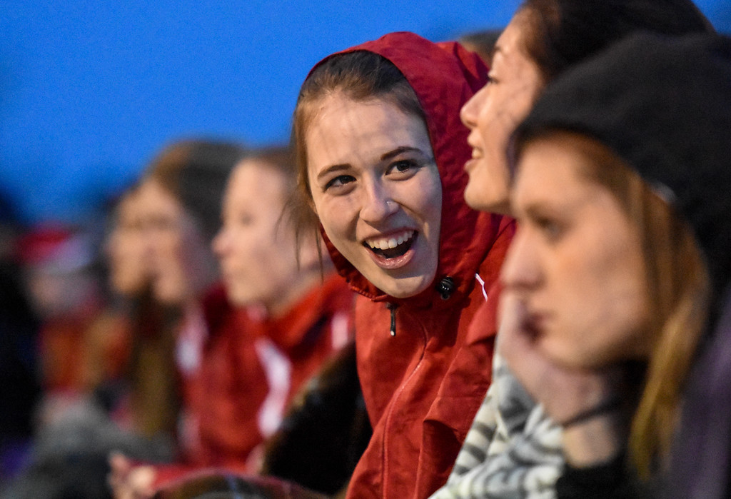 . Loveland\'s Kira Badberg laughs with teammates on Thursday March 8, 2018 at North Lake Park. (Cris Tiller / Loveland Reporter-Herald)